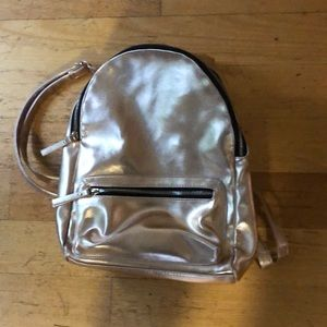 Rose gold backpack with adjustable straps. Excellent condition.